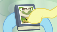 Fluttershy pointing at Martingale's name S9E21