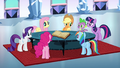 Main 6 singing around a table S3E1.png