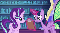 Twilight Sparkle looking at lesson checklist S6E21