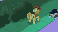 Braeburn looks around the bushes S9E17