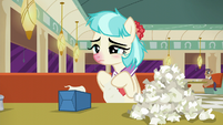 Coco Pommel with pile of used tissues S6E9