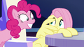 Fluttershy cowers away from Pinkie S6E1.png