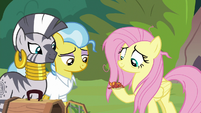 Fluttershy holding the gecko in her hoof S9E18