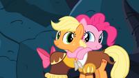 Pinkie Pie and Applejack hugging S2E11