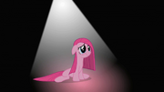 Pinkie surrounded by darkness under a cone of light S01E25