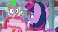 Twilight and Spike look worried at each other S9E3
