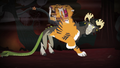Chimera's tiger head trying to remove chair out of mouth S4E17.png
