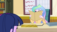 Principal Celestia with her face in a folder EG
