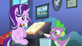 Spike blows dust off Starlight's lesson cards S6E21.png