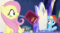 Books float past Fluttershy and Rainbow Dash S7E25