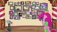 Pinkie Pie looking at wall of photographs BFHHS3