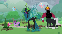 Queen Chrysalis pointing behind her S9E25
