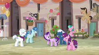 Starlight Glimmer surrounded by laughing villagers S6E25