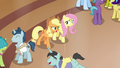 Applejack and Fluttershy enter the resort lobby S6E20.png