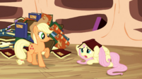 Fluttershy hides under book S3E05