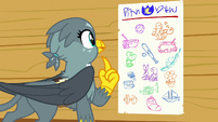 Gabby looking at the cutie mark chart S6E19