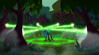 Queen Chrysalis blasting magic at the trees S8E13