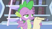Spike begins reading Celestia's reply S1E01