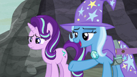 Trixie pointing at the village S6E25