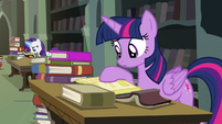 Twilight looking through library books S4E25