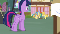 Twilight sees ponies crowded around Fluttershy S7E14