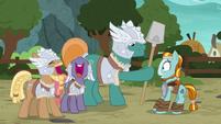 Green MH pony giving Rockhoof a shovel S7E16