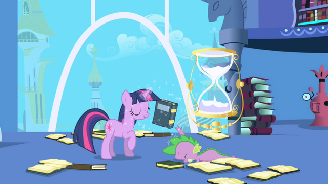 Файл:Twilight pulls desired book from Spike's grasp S1E01.png