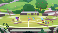 Wide view of cheer squad on the field S9E15
