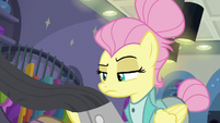 Fluttershy looking at jacket on the rack S8E4