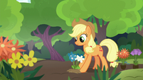 Applejack planting flowers at the sanctuary S7E5