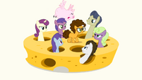 Ponies and a flying pig looking at Cheese angrily S4E12