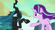 Queen Chrysalis reaching for Starlight Glimmer's hoof S6E26