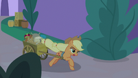 Applejack pulling a cart of baking materials S9E17