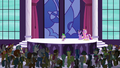 Spike addressing the delegates S5E10.png