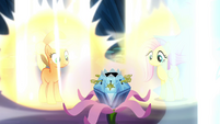 Applejack and Fluttershy looking at the chest S4E26