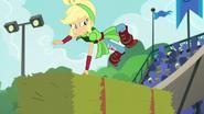 Applejack deftly leaps over a hay bale EG3