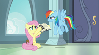 Fluttershy shows a picture to Rainbow Dash S9E21