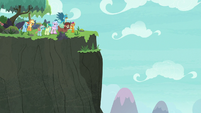 Ponies and students reach a big cliff S8E9