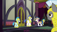 Shining Armor walks through guarded corridor S9E4