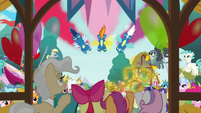 Wonderbolts flying over the ceremony S9E12