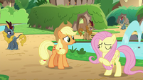 Fluttershy beckons Applejack to follow S8E23