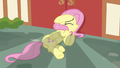 Fluttershy cowering in fear next to a building S7E14.png