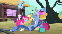 Discord lying on a pile of bags S4E11