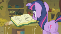 Twilight looking at Zecora's book S1E09