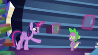 Twilight talking while levitating some books into bookshelf S5E22