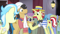 Flam holding a stallion's hoof S4E20.png