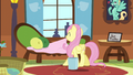 Fluttershy fixing the couch S6E11.png