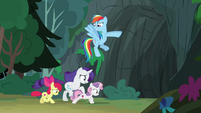 Rainbow Dash leads her friends into the cave S7E16