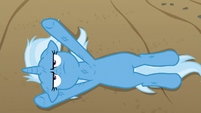Trixie lying flat on the road S8E19