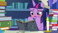Twilight Sparkle pulling on her lower eyelids S7E25